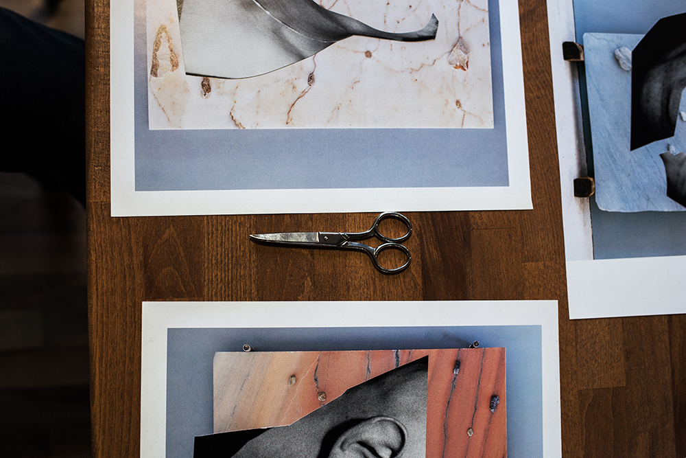 Scissor lying next to two analog collages
