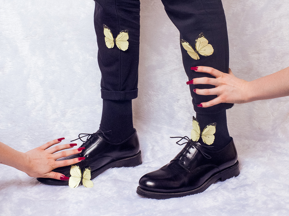 Standing legs with butterflies and hands on them